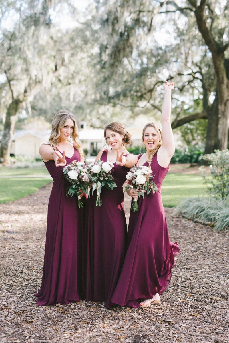 Haley's bridesmaids in their burgundy bridesmaid dresses
