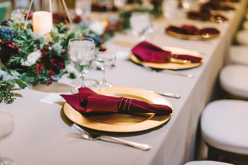 Gold and burgundy wedding guest table setting