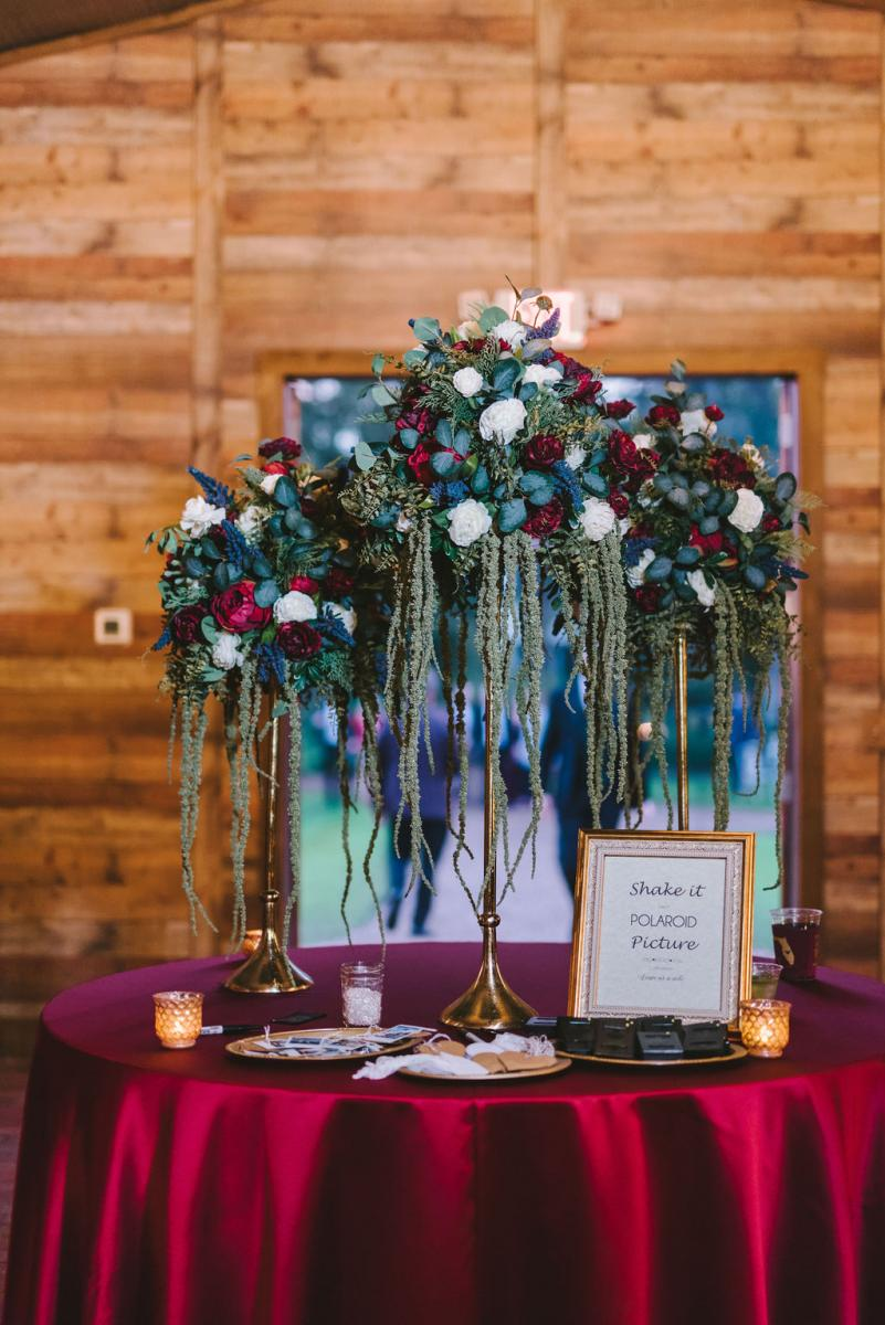Haley and Paul's modern boho entrance table inside the Carriage House Stable