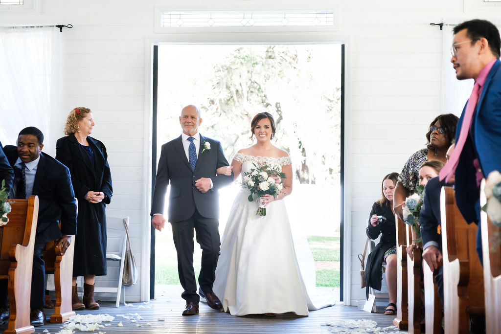 Haley walking down the aisle with her father