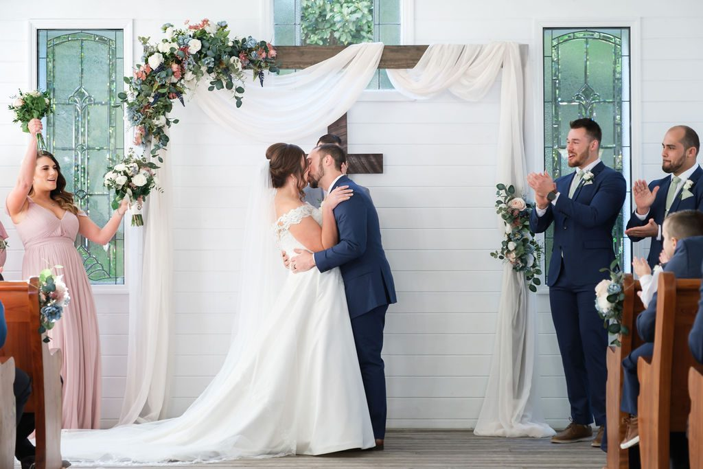 sweet first kisses as the new Mr and Mrs