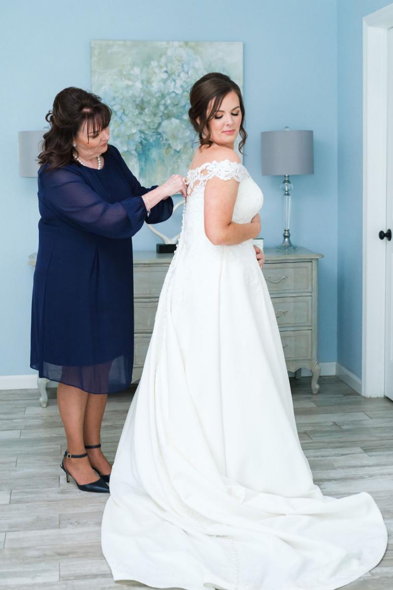 Haley getting in her wedding dress