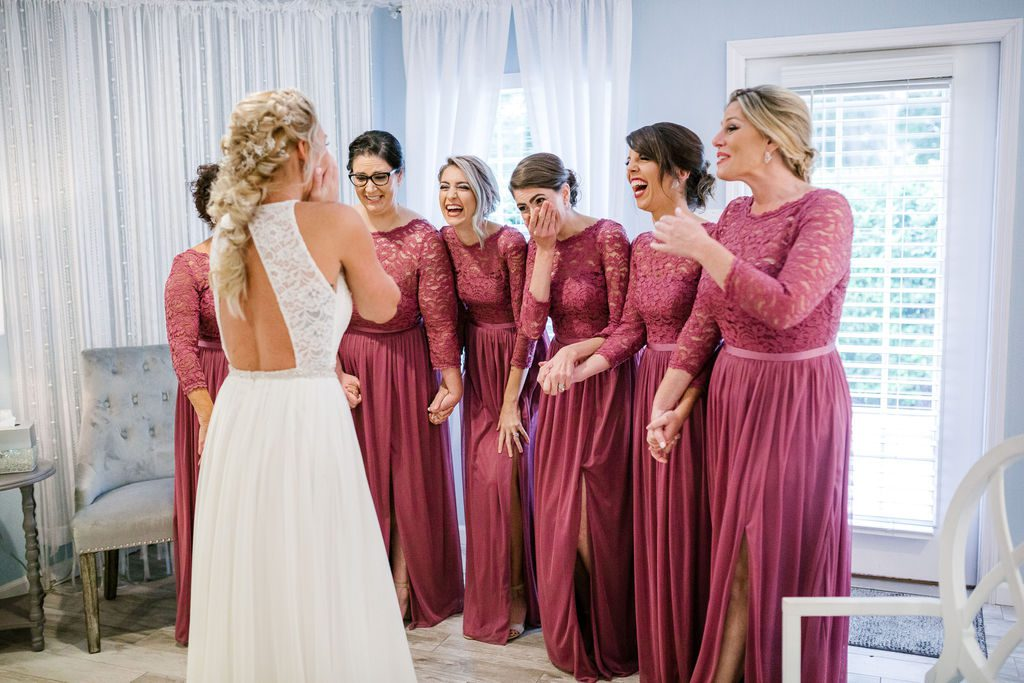 Sweet first look with bridesmaids