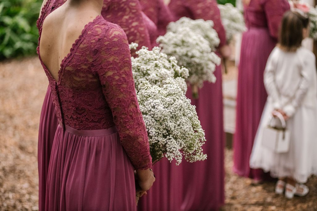 Baby's breath bouquets and mauve bridesmaid dresses