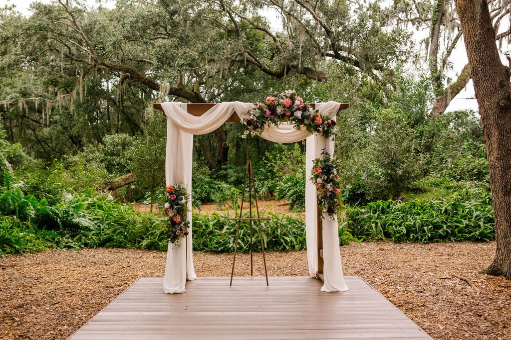 Wedding ceremony arch with draping