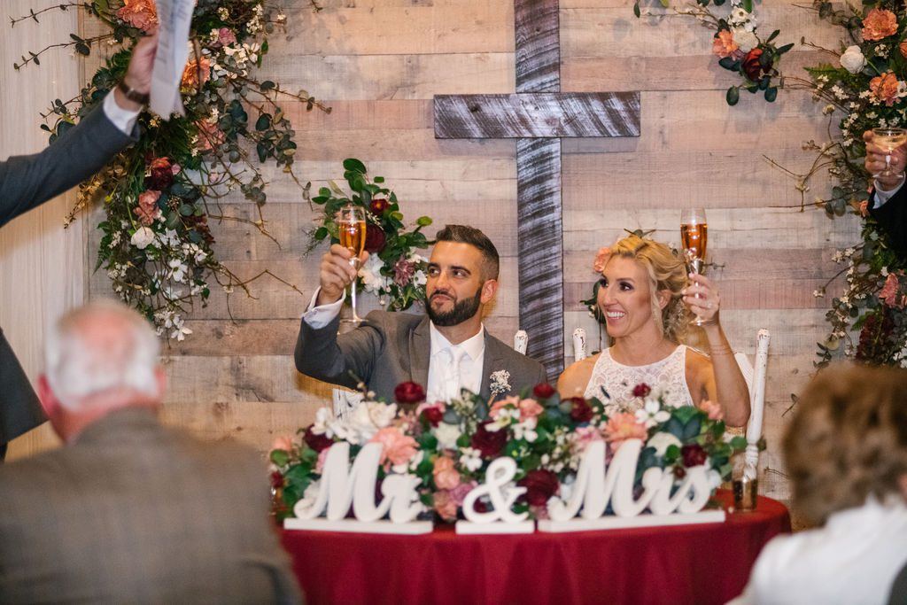Wedding toasts at the sweetheart table