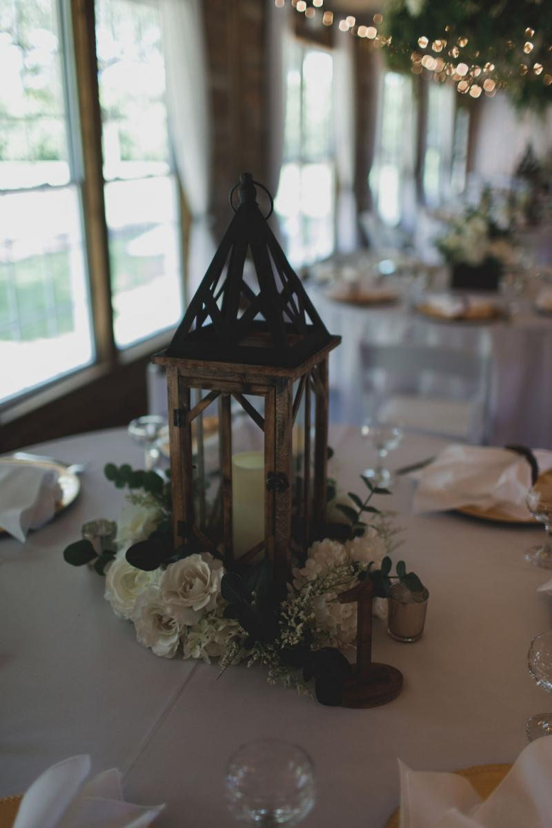 Wooden lanterns decorated some of the guest tables