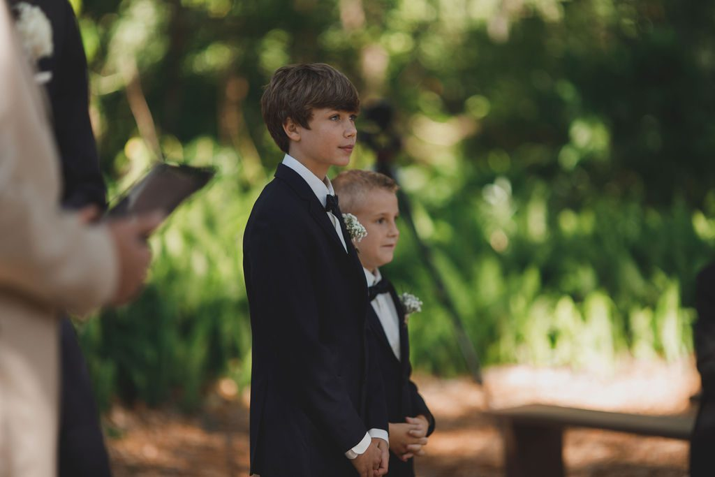Nicki and Shannon's son Emery waiting for Nicki to walk down the aisle