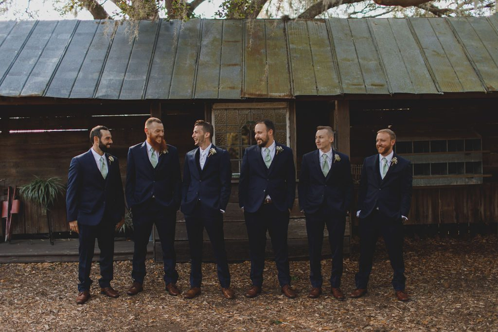 Nathaniel and his groomsmen wore ties in the same color as the bridesmaid's dresses.