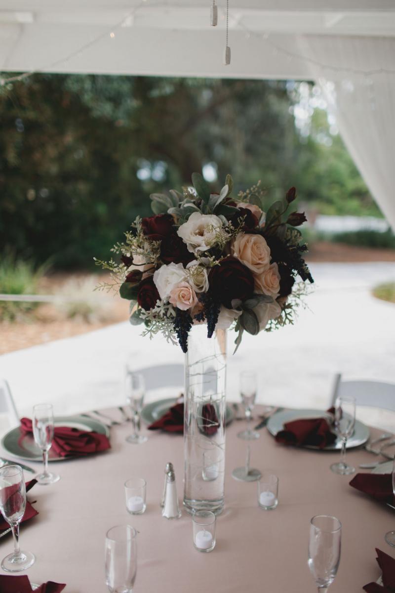 Tall glam burgundy and blush wedding decor