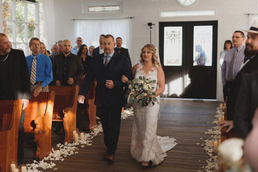 Shelbie walking down the aisle at the Chapel