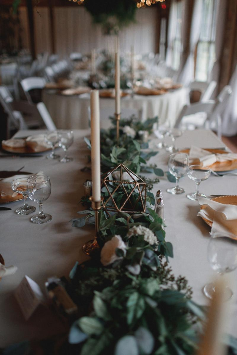 Garlands of greenery and candle centerpieces