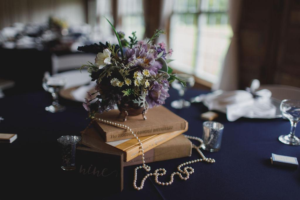 vintage book themed wedding centerpiece