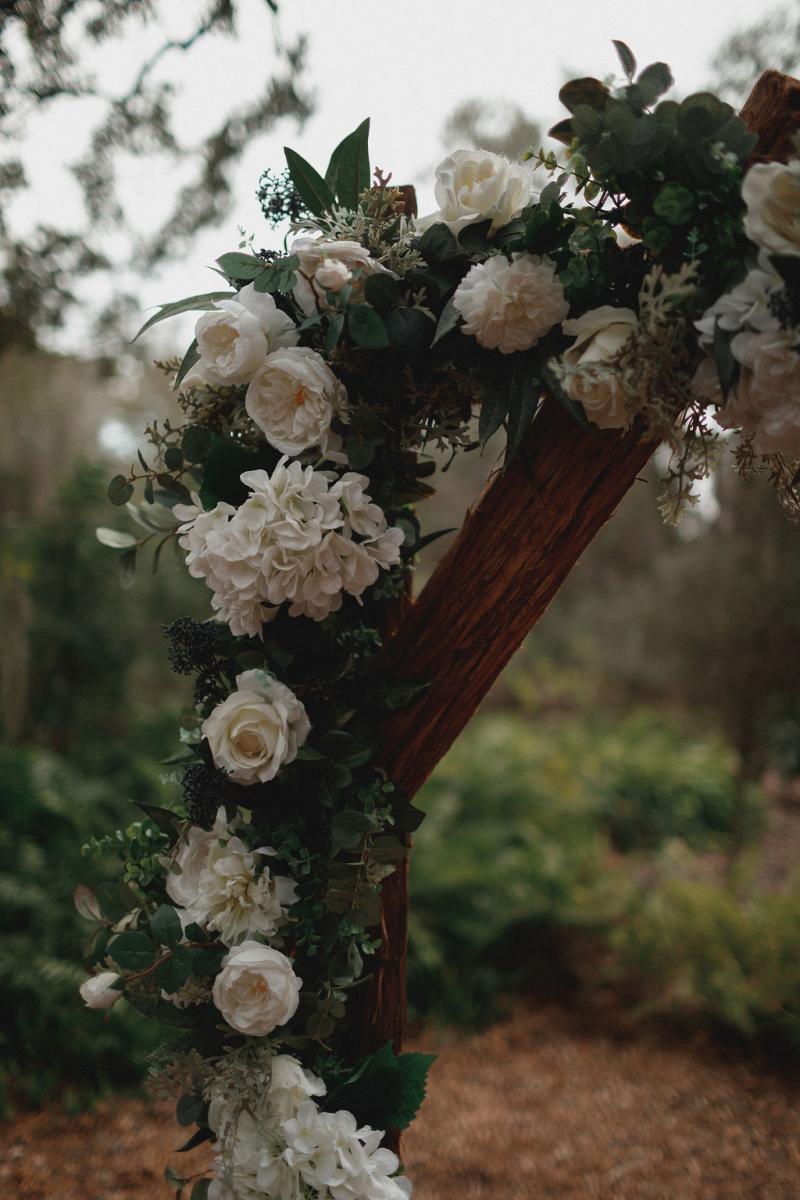 Rustic wedding ceremony arch