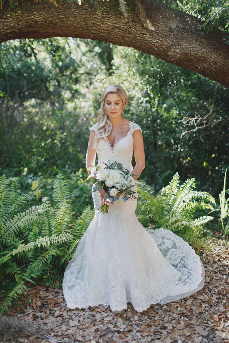 Nicki's wedding dress with cap sleeves, sweetheart neckline and full lace fit and flair