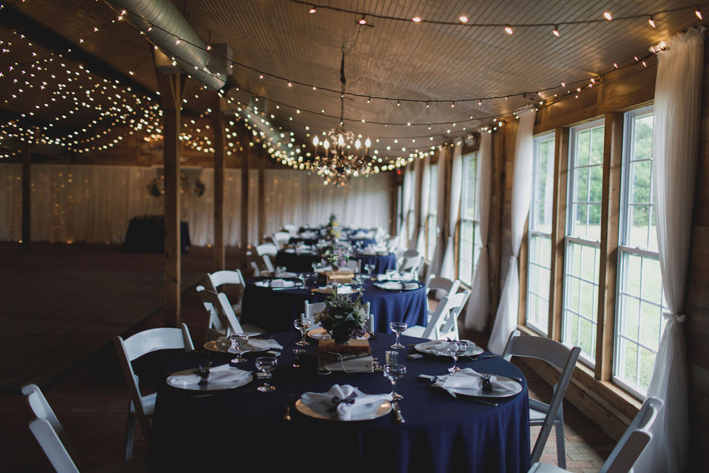 Vintage royal blue wedding reception at the Carriage House Stable