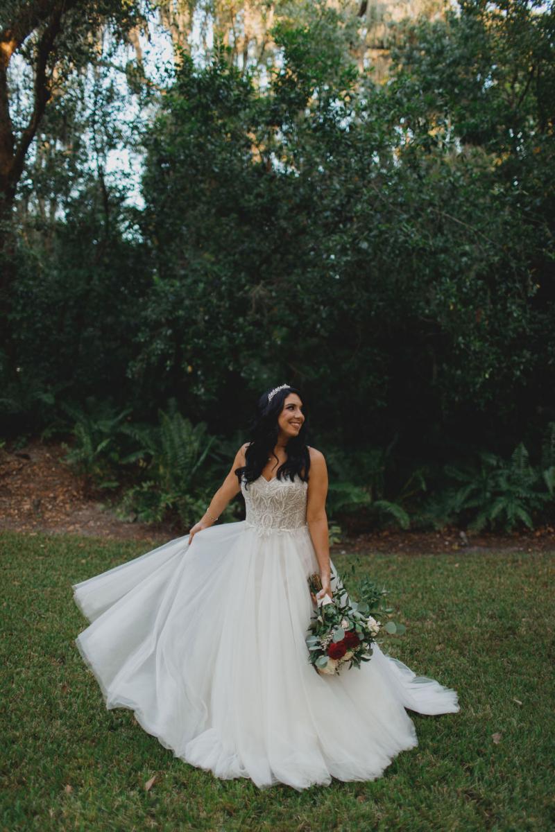 Jennifer twirling in her Justin Alexander wedding dress