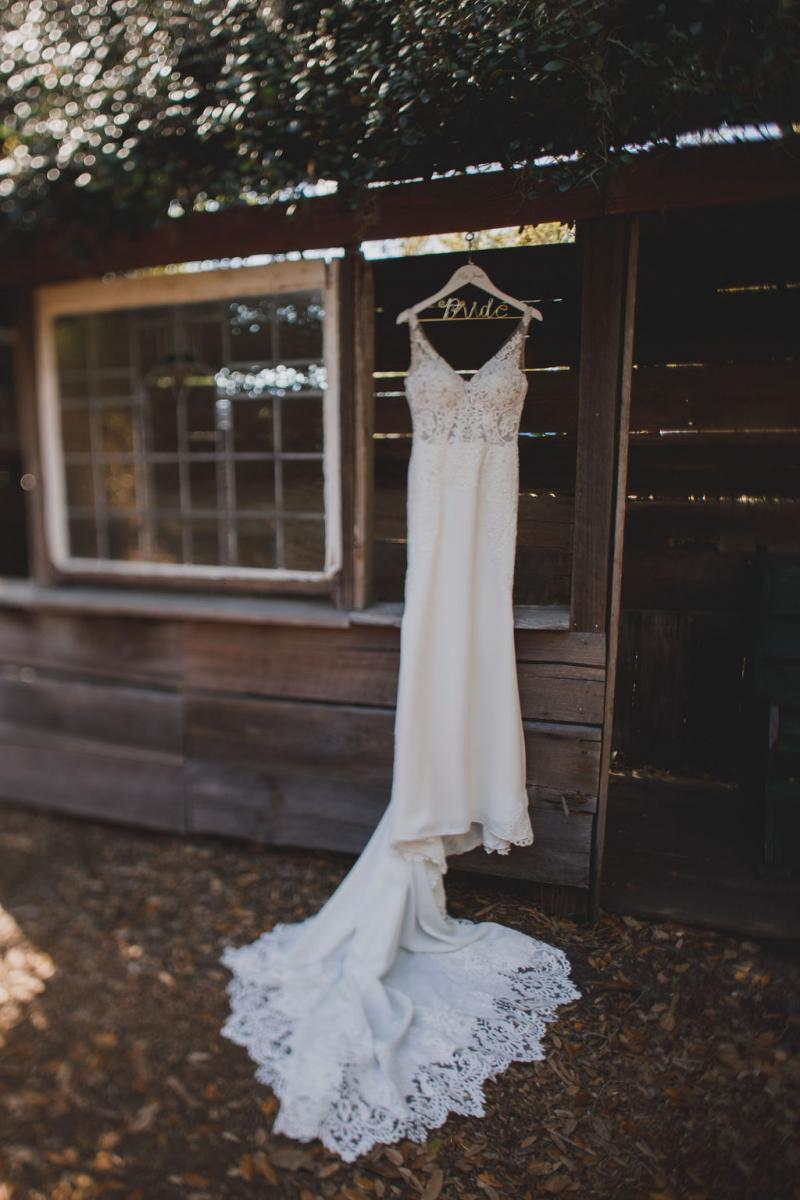 Megan's gorgeous fitted wedding gown with lace detailing