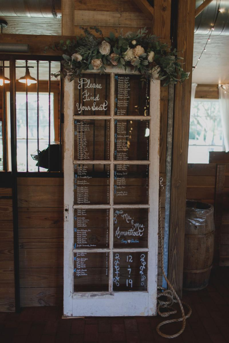 Hand written, antique door wedding seating chart