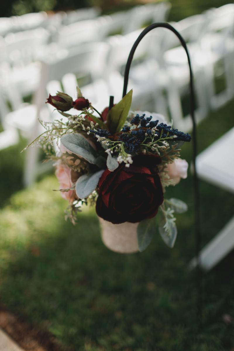 Blush and burgundy ceremony aisle decor
