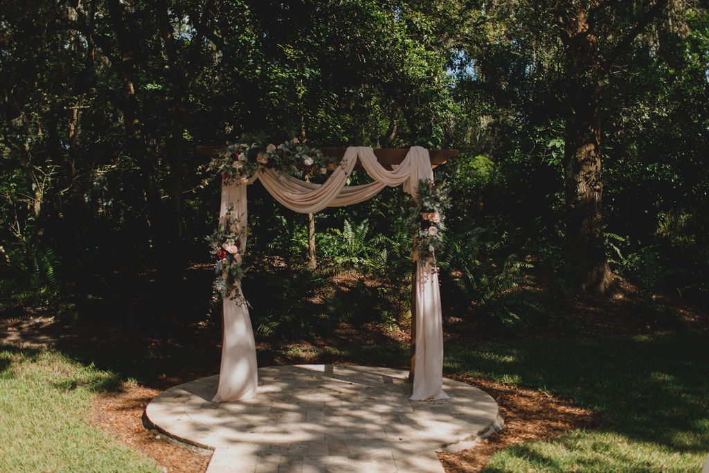 Wooden ceremony arch with blush draping