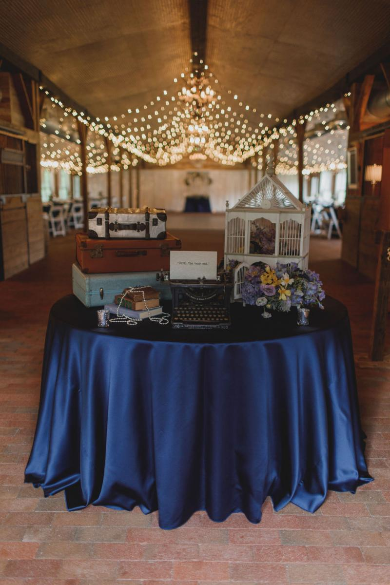 Vintage book-themed wedding reception entrance table