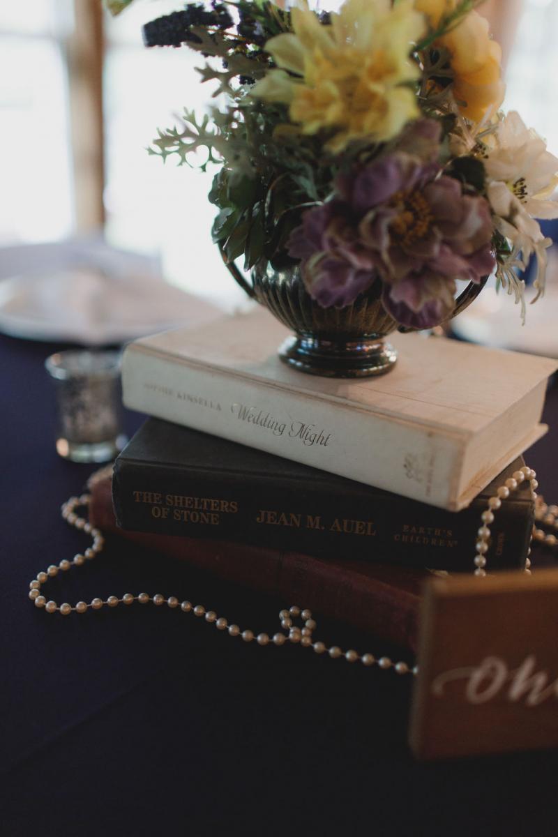 Vintage book-themed wedding centerpiece
