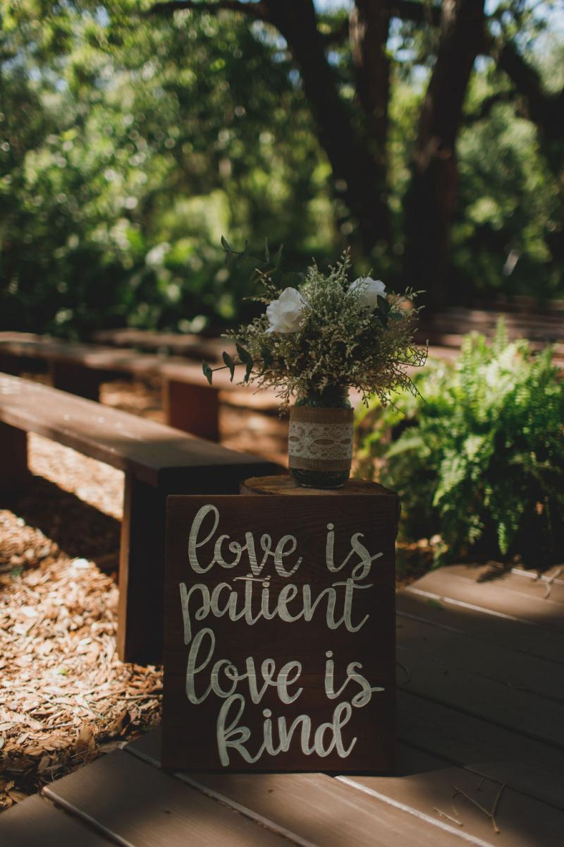 Love is patient, love is kind sign for the ceremony aisle decor