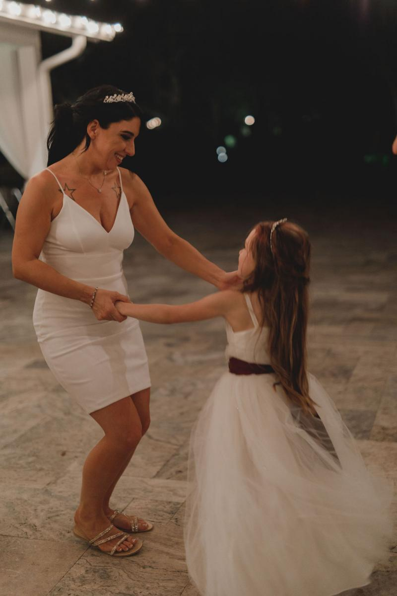 Jennifer and her daughter dancing the night away
