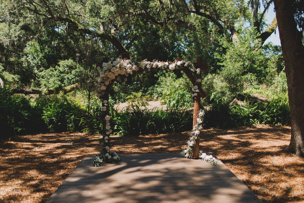 The elegant ceremony arch at the Enchanted Forest