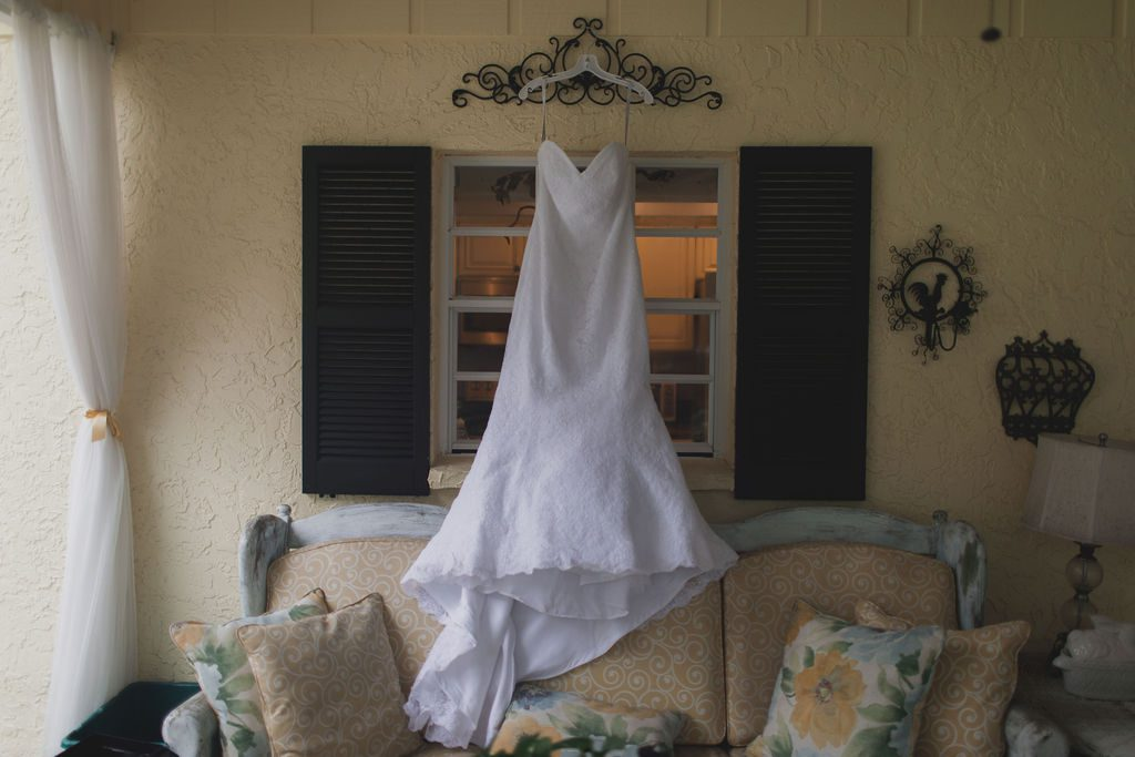 Lindsay's wedding dress hanging at the Main House