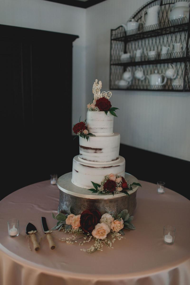 Glam 3-tier semi-naked wedding cake