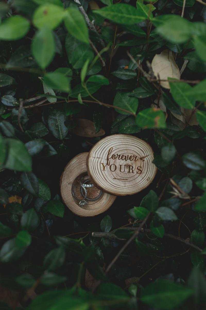 """Wooden rings box that reads """"Forever Yours"""""""