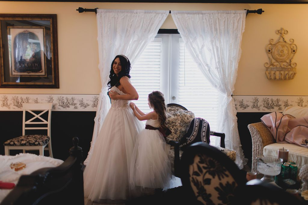 Jennifer's daughter helping her get ready for her big day