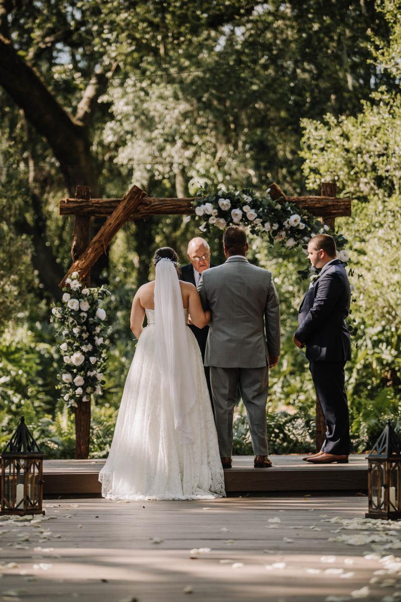 Ashlyn walking down the aisle with her father