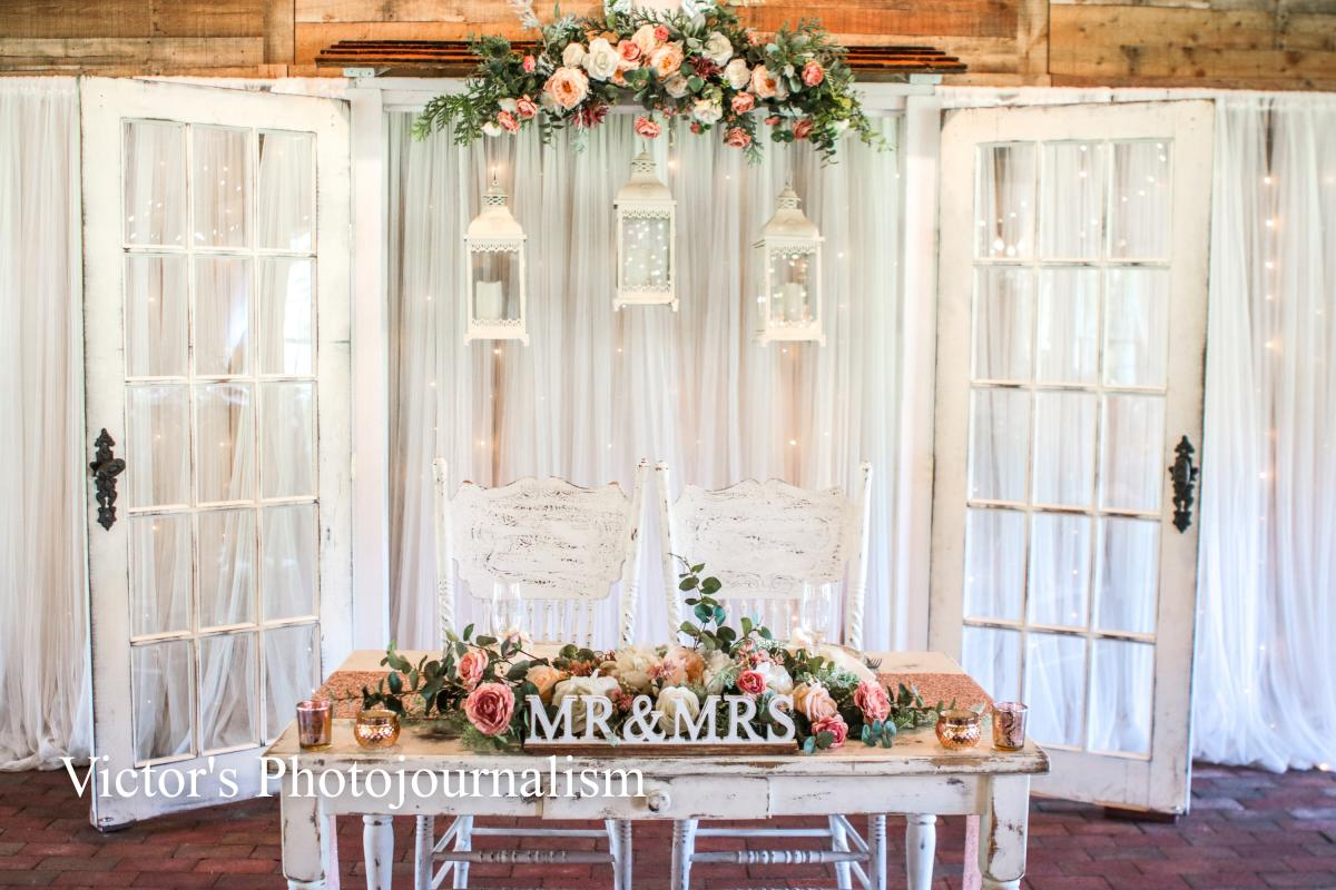 Vintage rose-filled sweetheart table