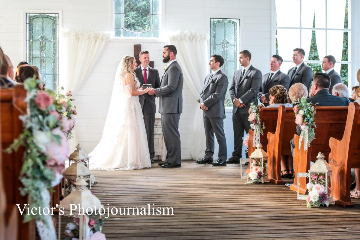 Jenna and Jeremy exchanging vows in the Chapel