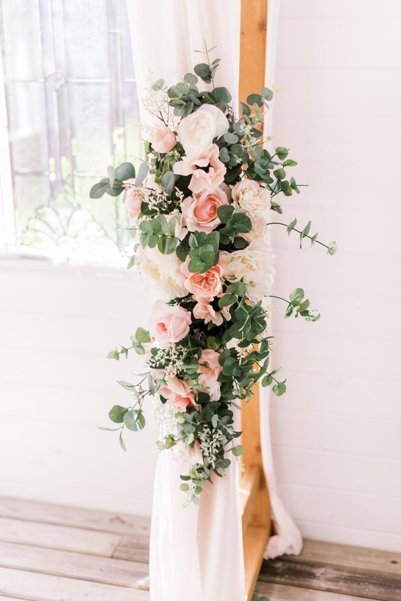 Sage green, blush and white ceremony arch decor