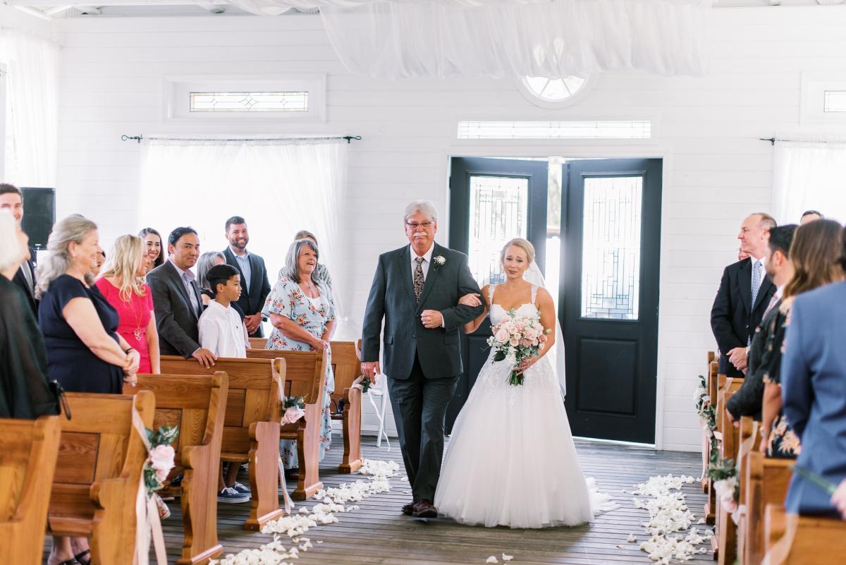Mikaela walking down the Chapel aisle