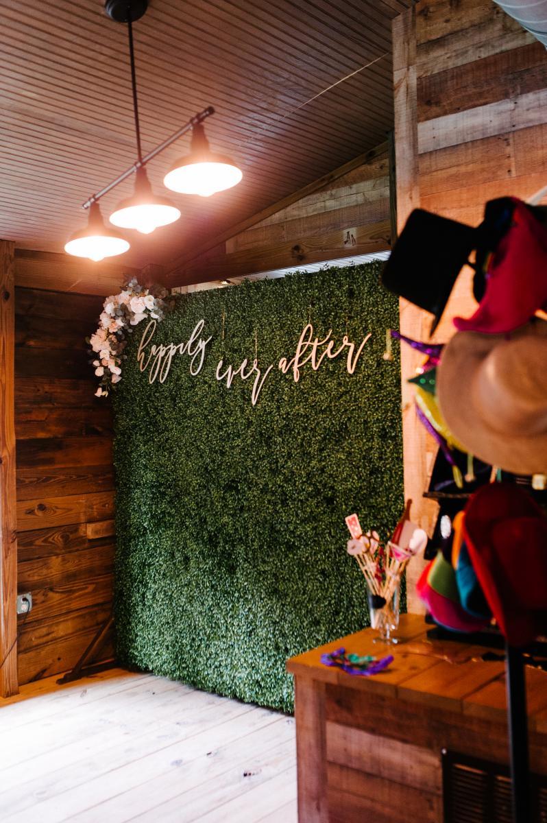 Greenery wall photo booth backdrop