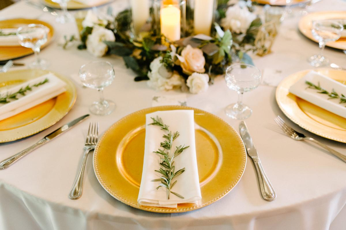 A spring of rosemary was placed on top of each napkin at the guests seats