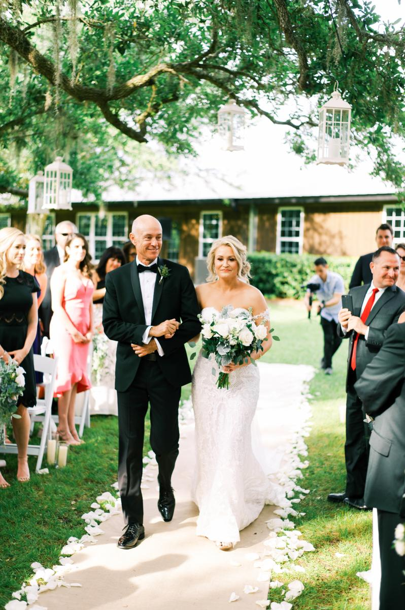 Krista walking down the aisle with her father