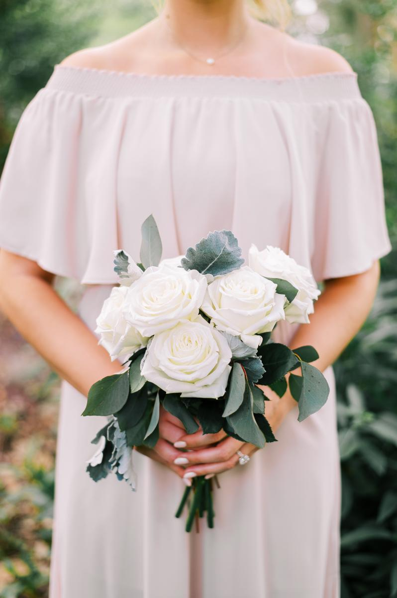 Modern all white roses bridesmaid bouquet