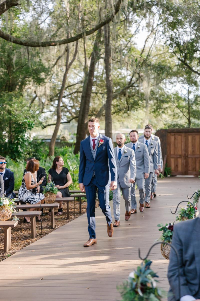 Jimmy and his groomsmen walking down the aisle