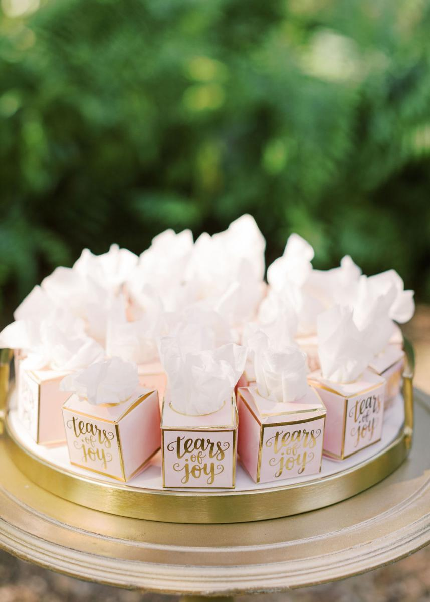 "Mini tissue boxes for guests to use during the ceremony that read ""tears of joy"""