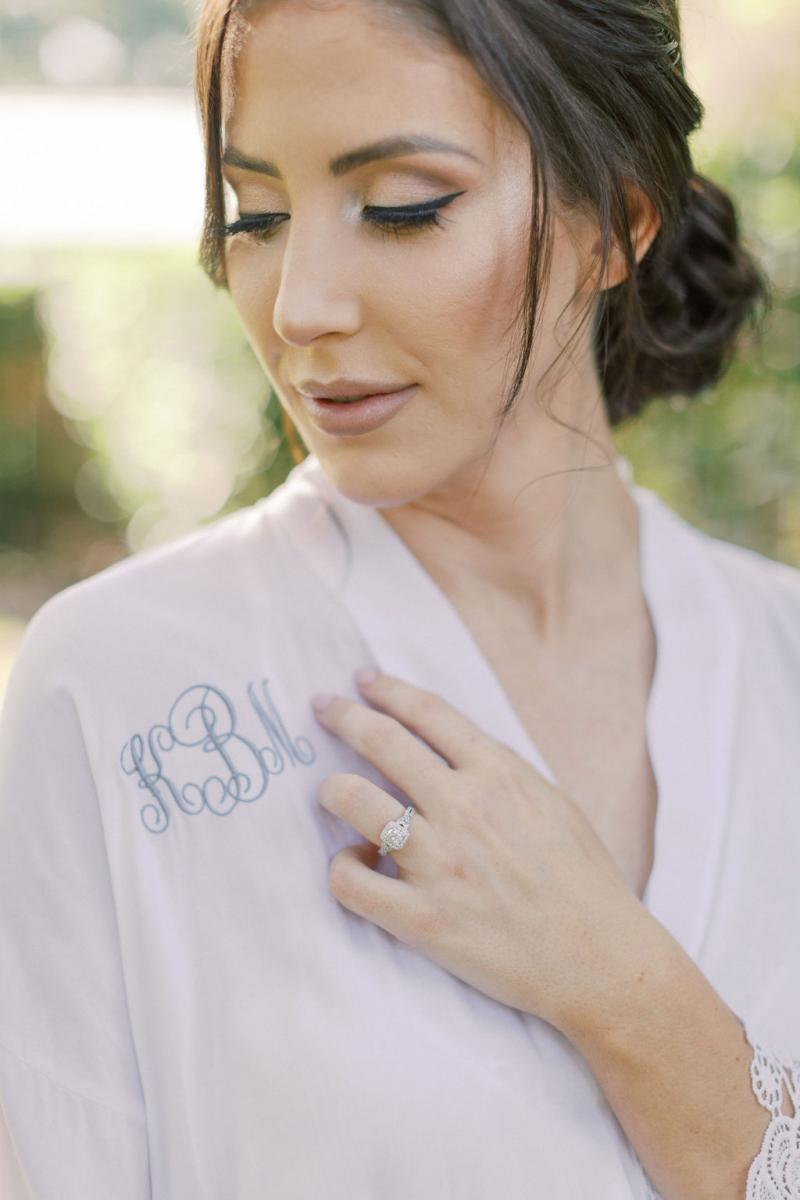 KC in her custom wedding robe stiched with her initials