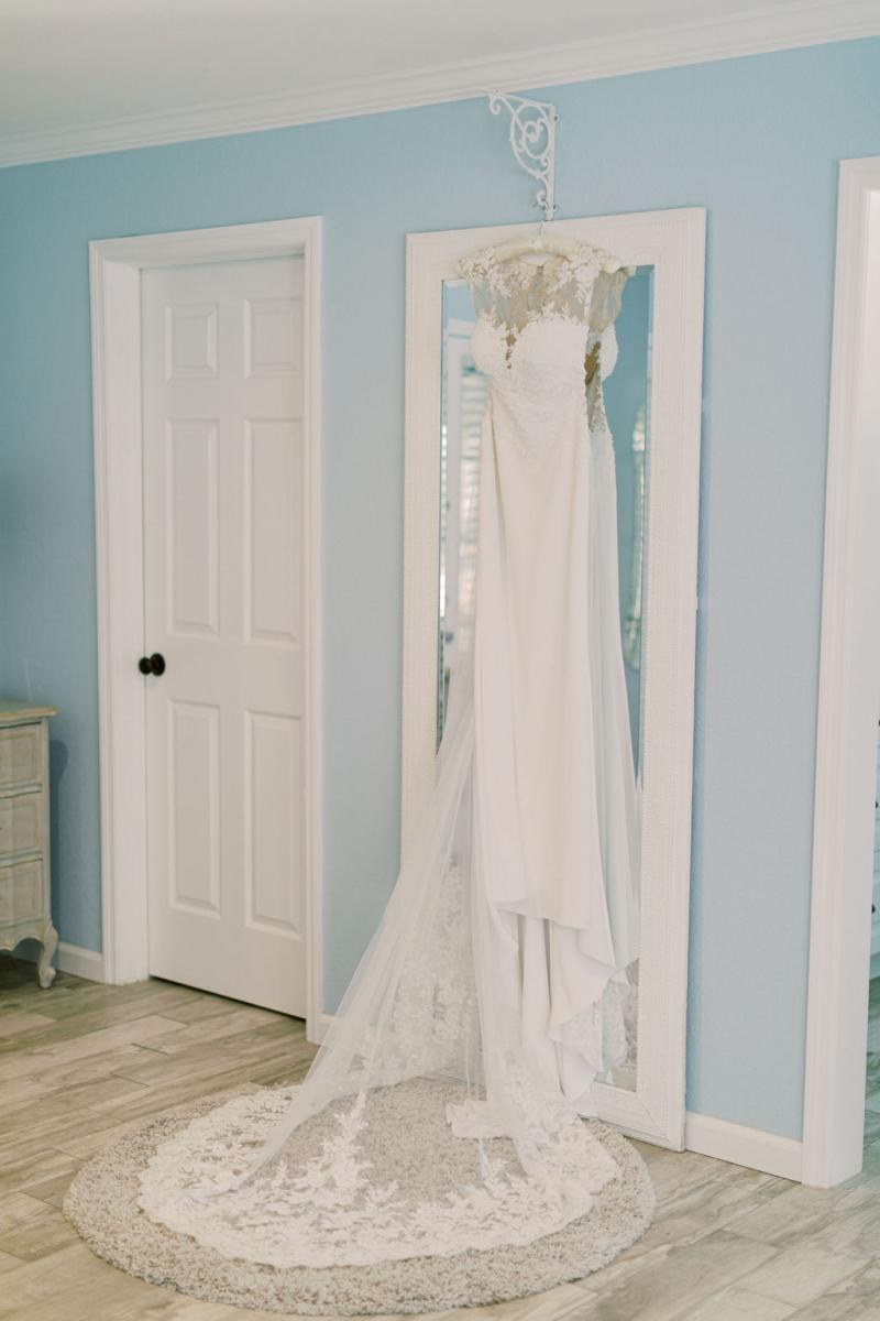 KC Dando London wedding gown hanging in the Bridal Cottage