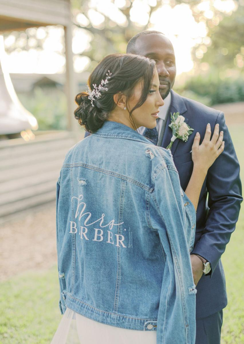 KC wore a jean jacket that said Mrs Barber on the back written in white