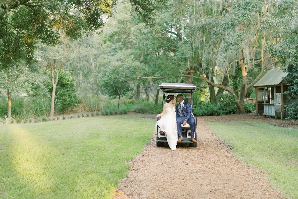 KC and Todd driving off to the reception in our golf cart