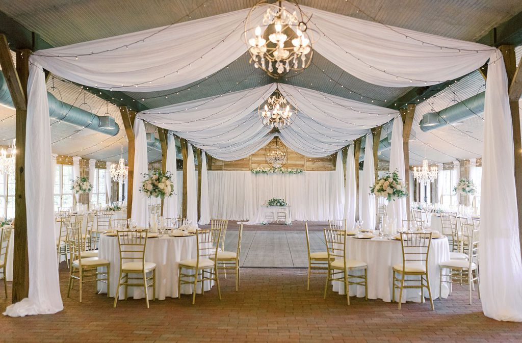 On The Move Productions added draping to the dreamy reception space